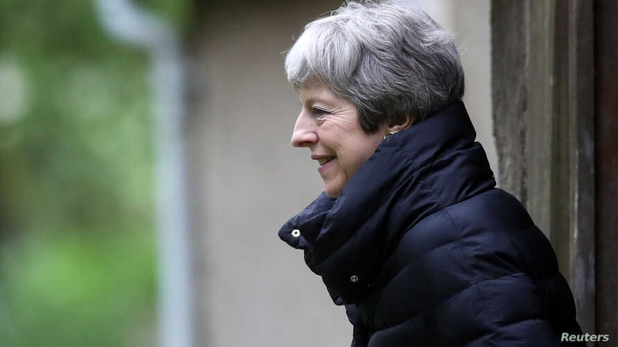 Britain's Prime Minister Theresa May leaves church, as Brexit turmoil continues, near High Wycombe, April 28, 2019.