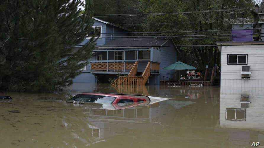 A truck is seen submerged in the flood waters of the Russian River in Forestville, north of San Francisco, Wednesday, Feb. 27, 2019.
