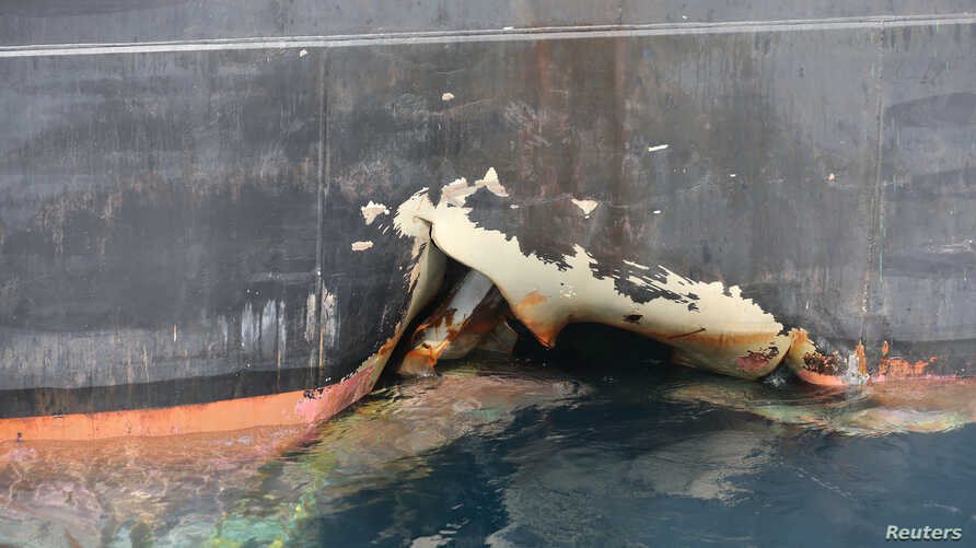 A damaged ANDREA VICTORY ship is seen off the Port of Fujairah, United Arab Emirates, May 13, 2019.