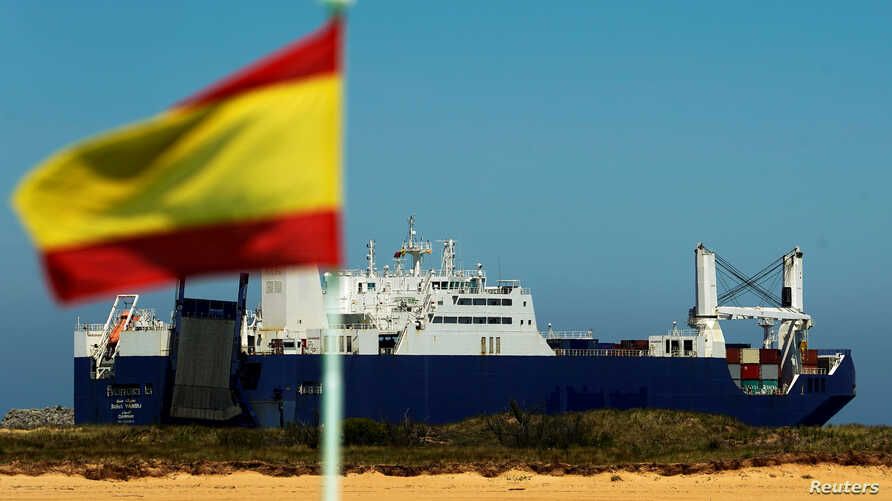 Saudi cargo ship Bahri-Yanbu passes a Spanish flag while departing the port of Santander, Spain, May 13, 2019.
