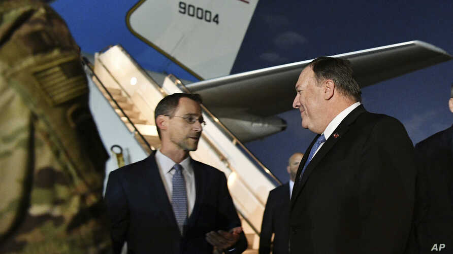 Secretary of State Mike Pompeo, center, talks with Charge D'affaires at the U.S. Embassy in Baghdad Joey Hood, left, after he arrived in Baghdad, for meetings, May 7, 2019. British Maj. Gen. Chris Ghika, a senior officer in the U.S.-led military coal...