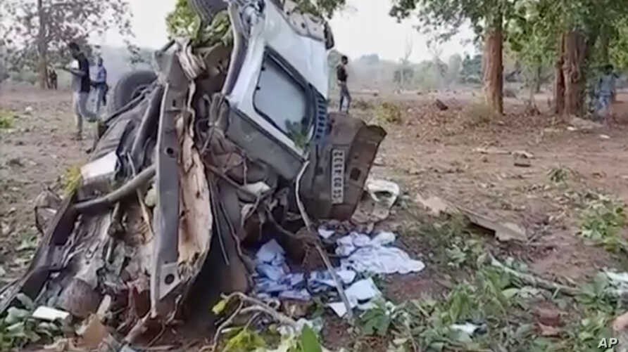 In this grab made from video provided by KK Productions, the wreckage of a car which came under an IED (improvised explosive device) blast is seen in the Dantewada district of Chhattisgarh, India,  April 9, 2019.