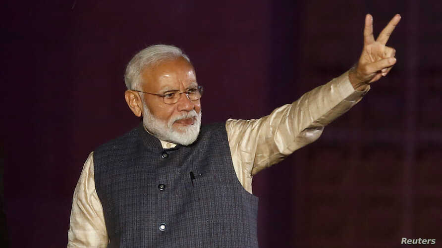 Indian Prime Minister Narendra Modi gestures toward his supporters after the election results at Bharatiya Janata Party (BJP) headquarter in New Delhi, India, May 23, 2019.