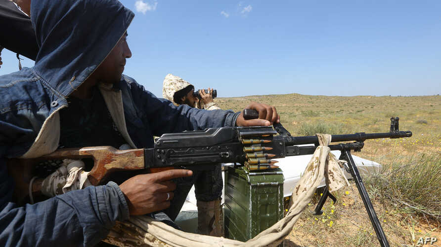 Fighters loyal to Libya's Government of National Accord (GNA) hold a position west of the city of Aziziah, some 60 kilometers southwest of the capital Tripoli, April 14, 2019.