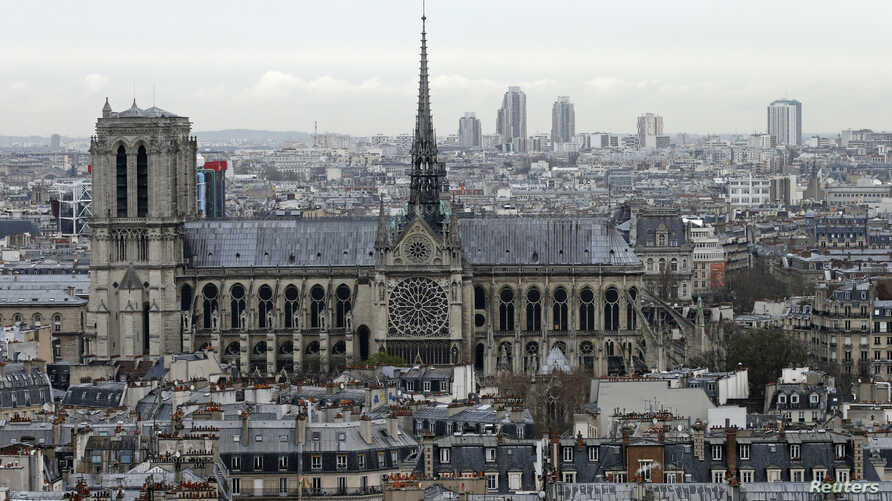 FILE - A city view shows the Notre Dame Cathedral on March 30, 2016, as part of the skyline in Paris, France.  The April 15, 2019 fire toppled the Gothic landmark's spire and damaged the roof.