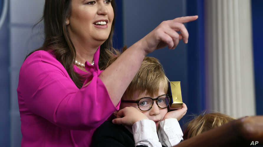 White House press secretary Sarah Sanders, standing next to her son Huck Sanders, calls on a child during a briefing at the White House in Washington, Thursday, April 25, 2019. Children of journalists and White House staff were invited to attend the ...