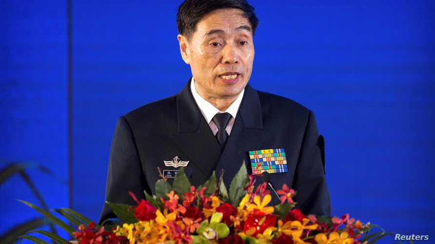 Vice Admiral Shen Jinlong, commander of the Chinese People's Liberation Army (PLA) Navy, speaks at a welcome reception for the commemoration of the 70th anniversary of the founding of the China's navy in Qingdao, Shandong province, China, April 22, 2...