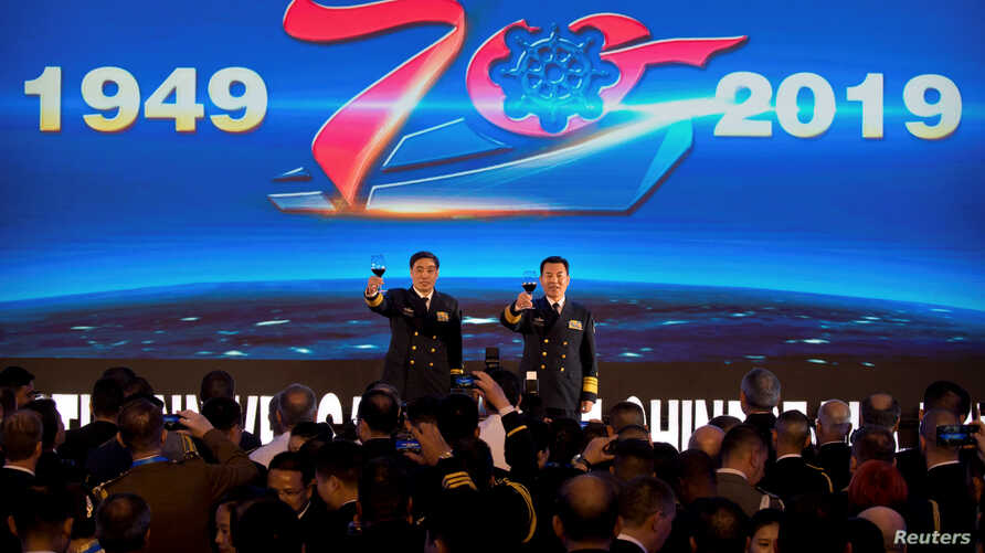 Vice Admiral Shen Jinlong, commander of the Chinese People's Liberation Army (PLA) Navy, and Vice Admiral Qin Shengxiang, political commissar of the PLA Navy, give a toast at a welcome reception for the commemoration of the 70th anniversary of the fo...