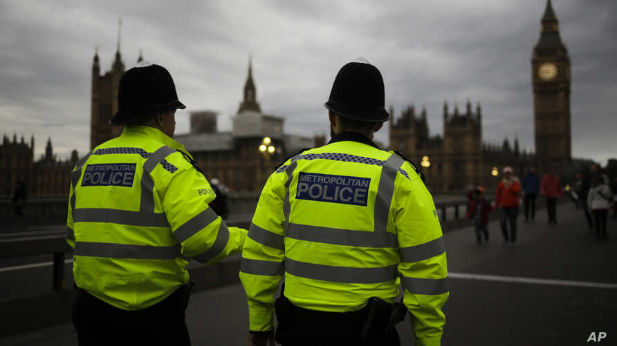 FILE - Police officers patrol Westminster Bridge with the Houses of Parliament in the background, in London, Britain, June 8, 2017.