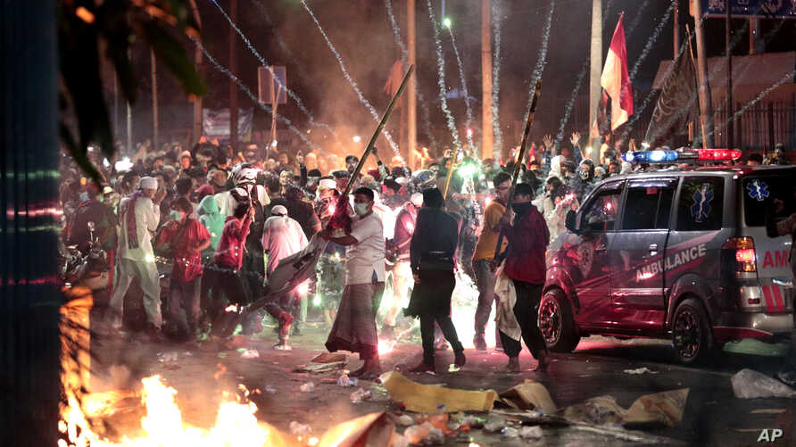 Fire crackers explode near supporters of presidential candidate Prabowo Subianto during clashes with the police in Jakarta, Indonesia,  May 22, 2019.