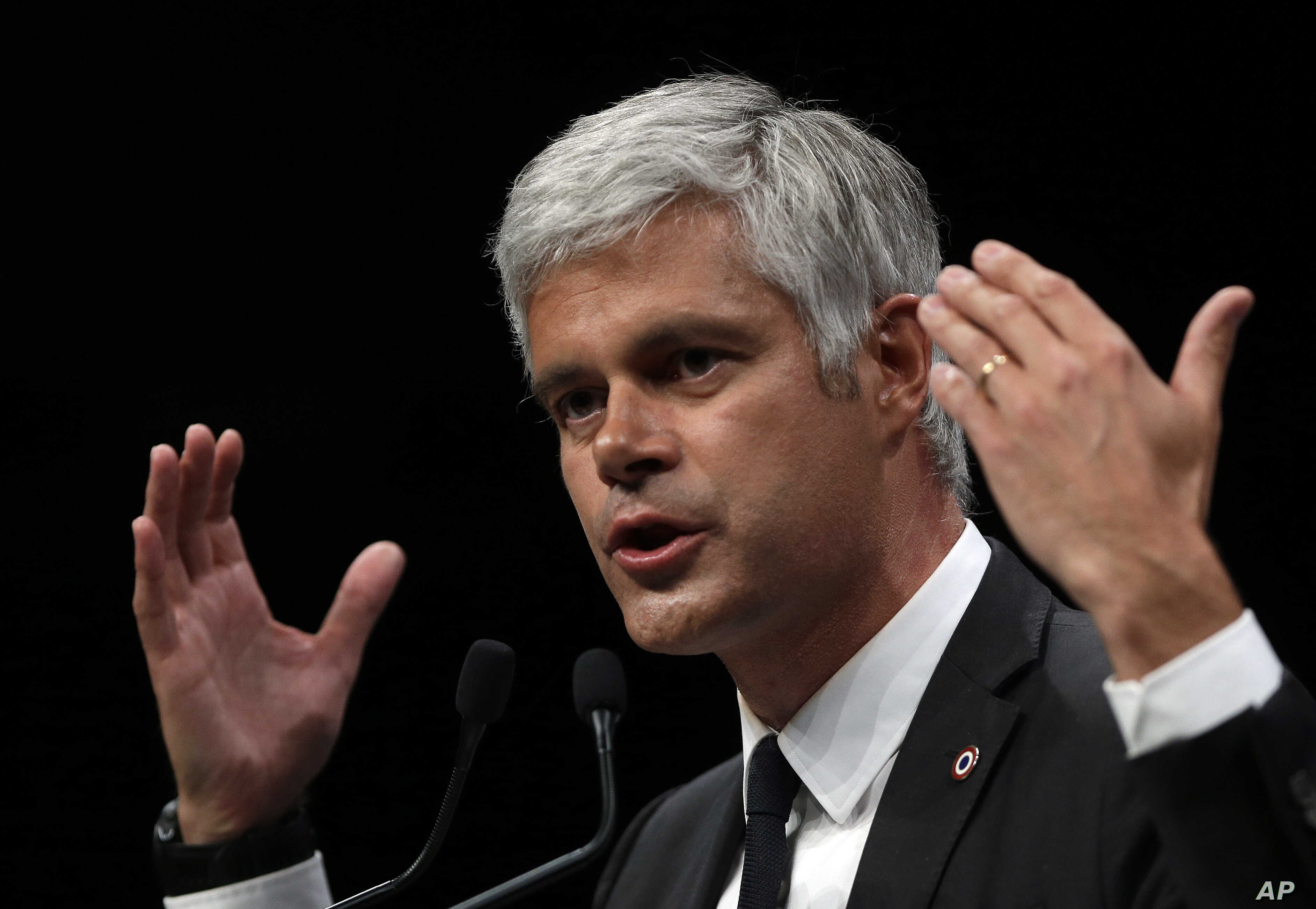 FILE - Laurent Wauquiez, President of the Republican Party, delivers his speech during a campaign meeting in Marseille, southern France, May 6, 2019.