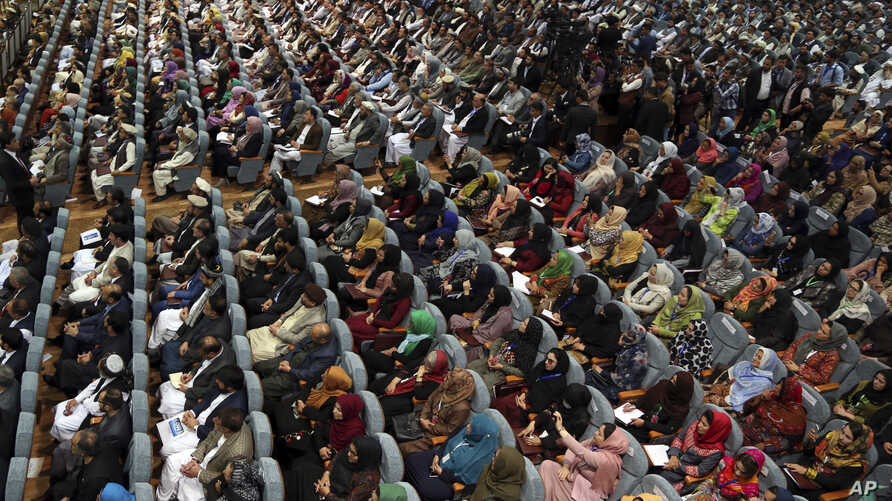 Members of the Afghan Loya Jirga are seated during the first day of the Loya Jirga, or the consultative council in Kabul, Afghanistan, April 29, 2019