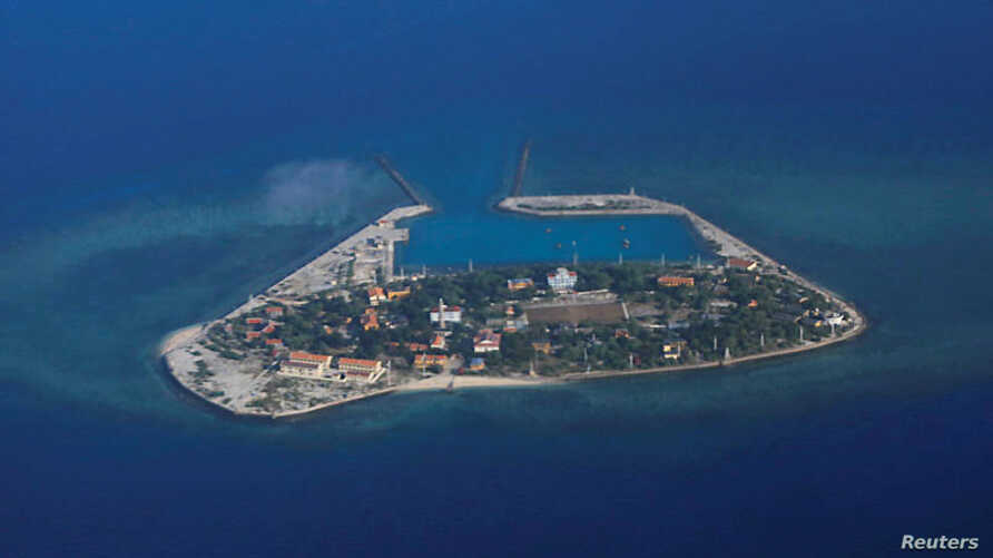 FILE - An aerial view of Southwest Cay, also known as Pugad Island, controlled by Vietnam and part of the Spratly Islands in the disputed South China Sea, April 21, 2017.