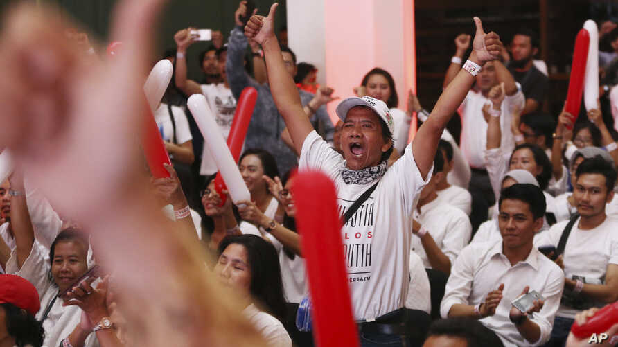 Supporters of Indonesian President Joko Widodo celebrate during a rally in Jakarta, Indonesia, April 21, 2019.