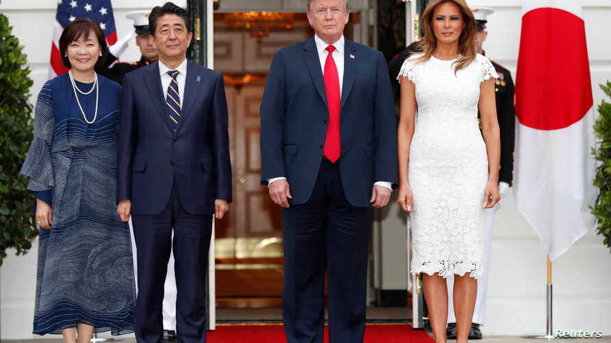 U.S. President Donald Trump and first lady Melania Trump welcome Japan's Prime Minister Shinzo Abe and Mrs. Akie Abe prior to having dinner at the White House, in Washington, April 26, 2019.