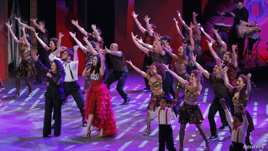 "FILE - Gloria Estefan (L) performs with Ana Villafane and the cast of ""On Your Feet"" during the American Theatre Wing's 70th annual Tony Awards in New York, U.S., June 12, 2016."