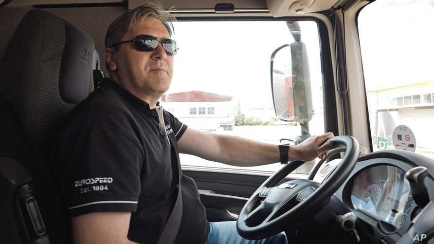 FILE - Bulgarian truck driver Ivan Gospodinov sits in a Eurospeed truck cab at a parking lot in Sofia, Bulgaria, May 8, 2019.