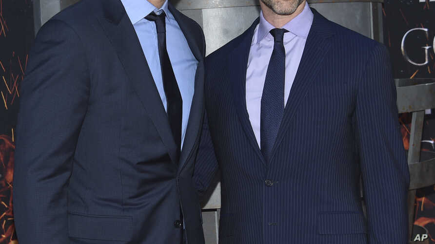 """Creator/executive producers David Benioff, left, and D. B. Weiss attend HBO's """"Game of Thrones"""" final season premiere at Radio City Music Hall on April 3, 2019, in New York."""
