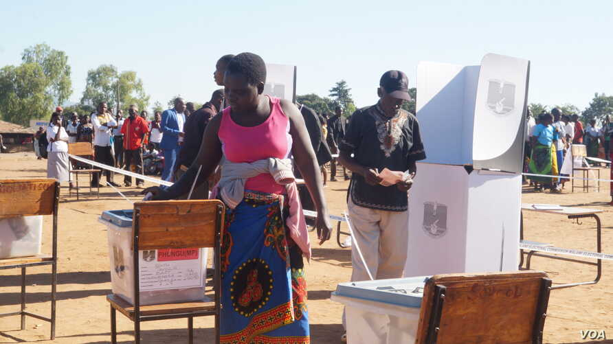 Malawians cast ballots May 21 in presidential and parliamentary elections. The results of the presidential vote must wait until about a third of the ballots are recounted.