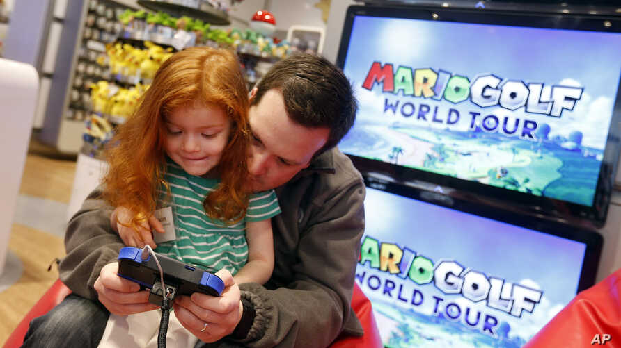 FILE - Kids attend an exclusive media event at Nintendo World in New York to play new games.