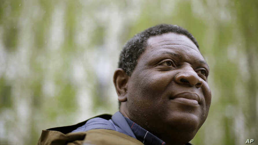 Goldman Environmental Prize winner Alfred Brownell, a Liberian environmental lawyer and human rights activist, stands for a photograph, in Boston, April 22, 2019.