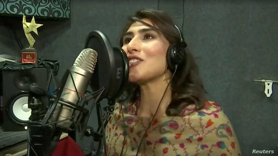 Sana Tajik, 20, performs in a music recording studio in this screen grab taken from an undated video.