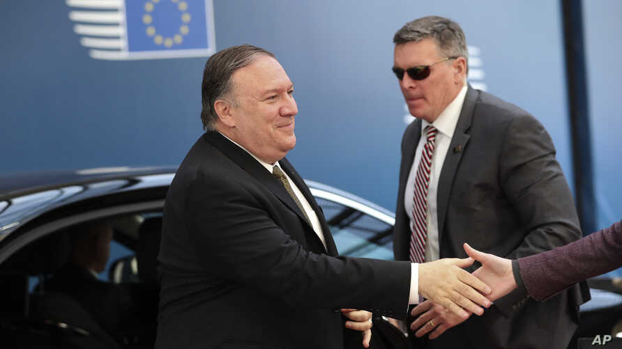 U.S. Secretary of State Mike Pompeo, left, arrives for a meeting with European foreign ministers at the Europa building in Brussels, May 13, 2019.