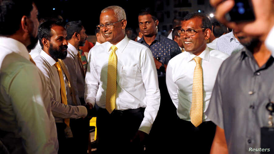 Maldives President Ibrahim Mohamed Solih and former president Mohamed Nasheed arrive at an election campaign rally ahead of their parliamentary election on Saturday, in Male, April 4, 2019.