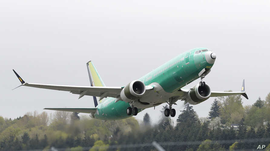 FILE - A Boeing 737 MAX 8 airplane being built for India-based Jet Airways, takes off on a test flight at Boeing Field in Seattle,  April 10, 2019. A global team of experts next week will begin reviewing how the Boeing 737 Max's flight control system...
