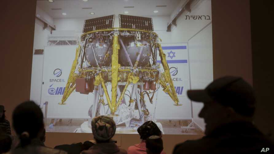 People watch the live broadcast of the SpaceIL spacecraft as it lost contact with Earth in Netanya, Israel, Thursday, April 11, 2019.