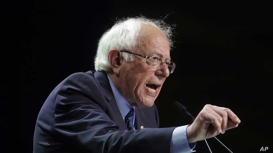 """FILE - In this June 2, 2019, file photo Democratic presidential candidate Sen. Bernie Sanders, I-Vt., speaks during the 2019 California Democratic Party State Organizing Convention in San Francisco. Sanders is lambasting Walmart's board including its CEO for paying its workers what he describes as """"starvation wages"""" and introduced a shareholder proposal that calls for hourly associates to have a seat on the company's board. (AP Photo/Jeff Chiu, File)"""