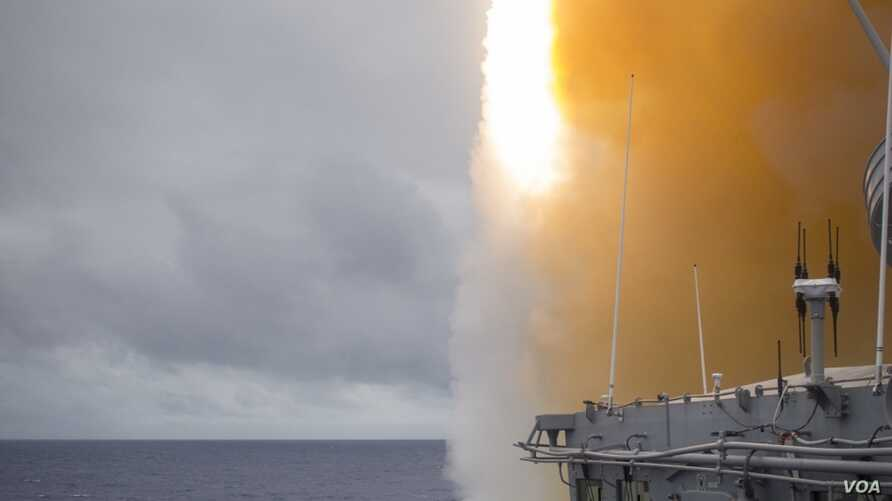 FILE - The Ticonderoga-class guided-missile cruiser USS Chancellorsville (CG 62) launched a Standard Missile (SM) 2 during a missile exercise (MSLEX) in the Philippine Sea.