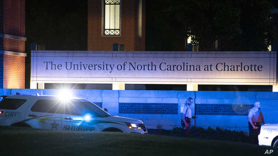Police secure the main entrance to UNC Charlotte after a shooting at the school that left at least two people dead, April 30, 2019, in Charlotte, N.C.