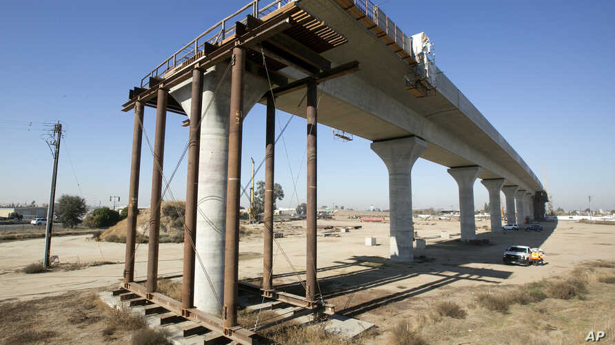 FILE -  One of the elevated sections of the high-speed rail under construction is seen in Fresno, Calif., Dec. 6, 2017.