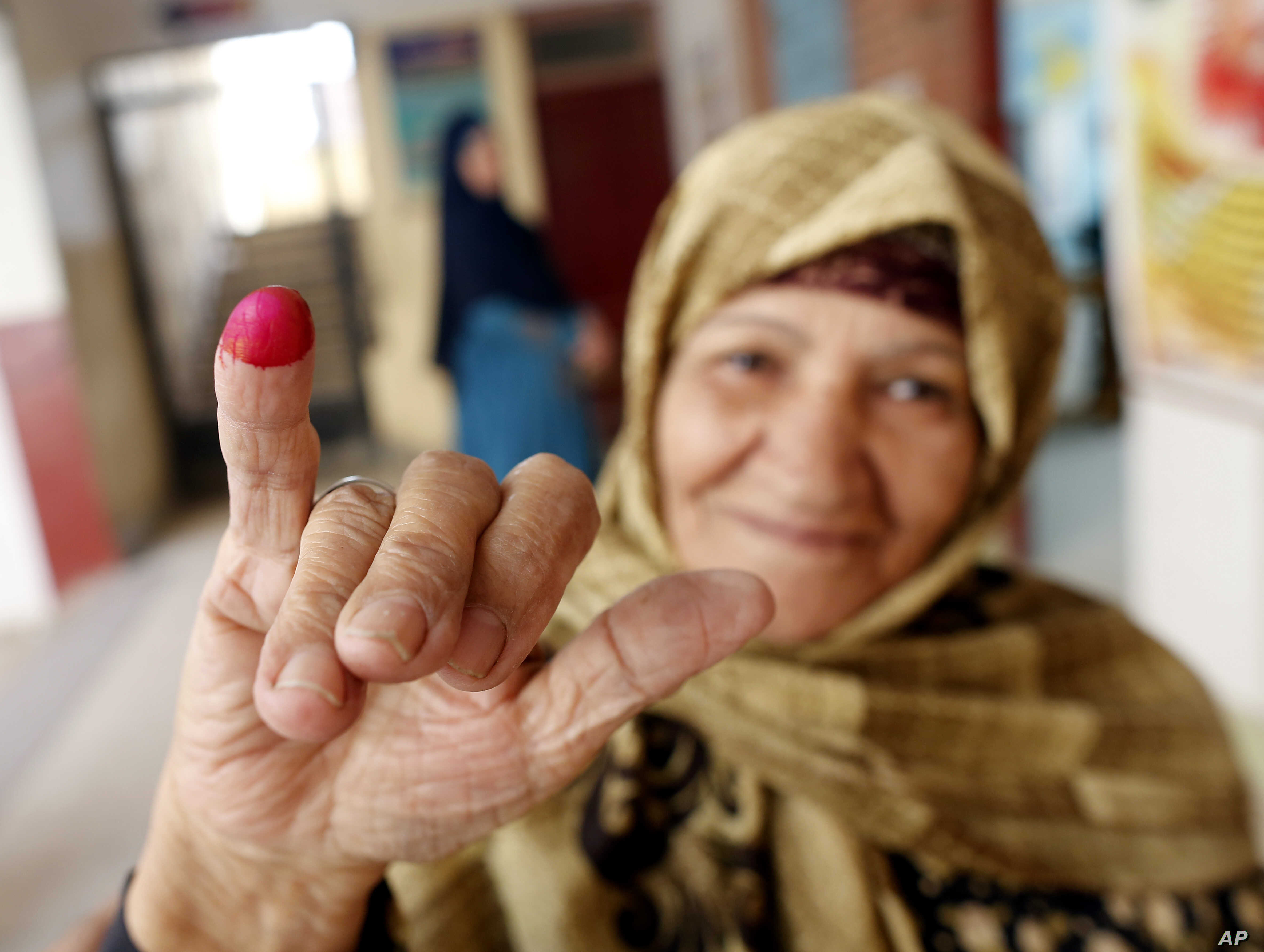 A voter displays her inked finger after she cast her ballot on constitutional amendments during the second day of three-day voting at polling station in Cairo, Egypt, April 21, 2019.