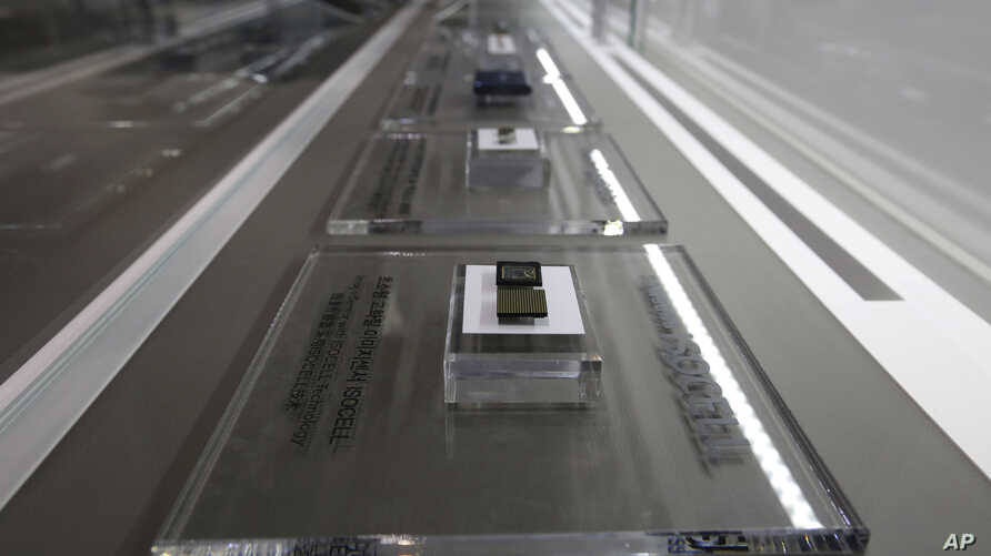 FILE - Samsung Electronics' microchips are displayed at its shop in Seoul, South Korea, Jan. 31, 2018.