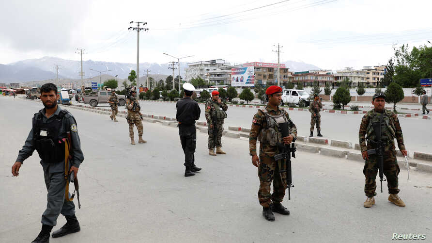 Afghan soldiers stand guard at the site of a blast in Kabul, Afghanistan, May 30, 2019.