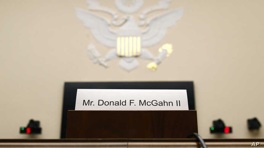 A placard is displayed for former White House Counsel Don McGahn, who did not appear before a House Judiciary Committee hearing, May 21, 2019, on Capitol Hill in Washington.