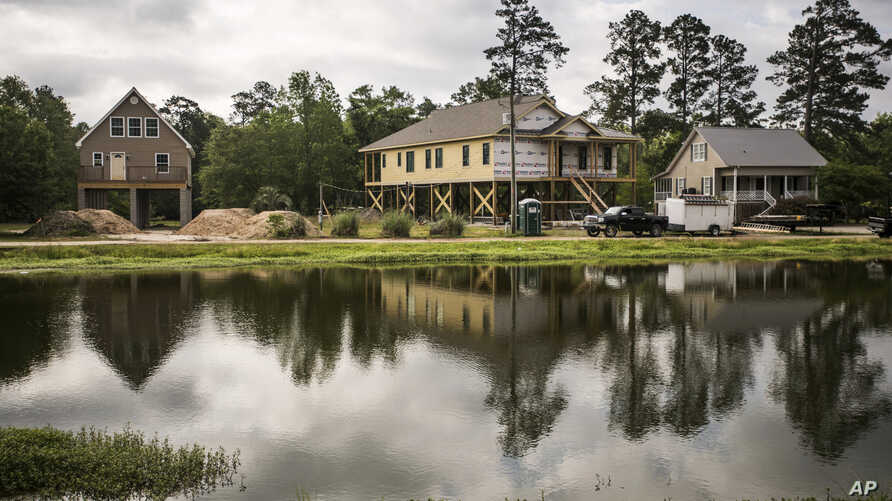 New homes are built on pillars along the Little Pee Dee River, in Nichols, S.C., May 13, 2019. Nichols suffered devastating flooding during Hurricane Matthew 2016 and Florence in 2018
