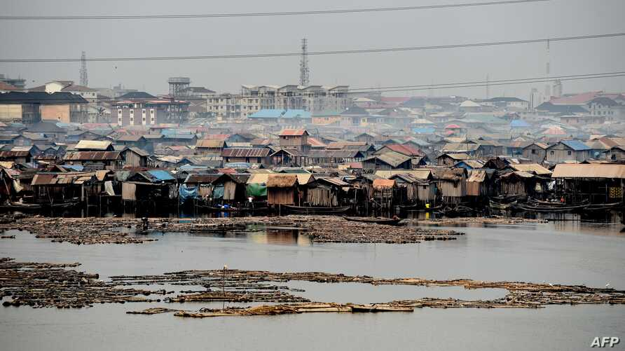 FILE - The make-shift shanty Makoko community built on the lagoon shows the extreme poverty and inequality between the rich and the poor in Lagos, Nigeria's commercial capital, Jan. 23, 2019.