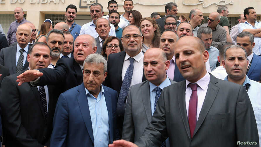 Employees of the Lebanese central bank gather during a strike over state budget proposals that would cut their benefits, in front of the central bank in Beirut, Lebanon May 6, 2019.