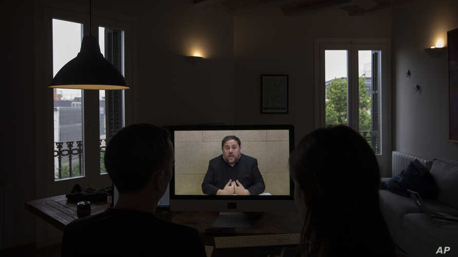 The leader of the Catalan ERC party and European Parliament candidate Oriol Junqueras speaks from Soto del Real prison in Madrid, Spain, May 24, 2019, during an interview via video conference with The Associated Press in Barcelona, Spain.