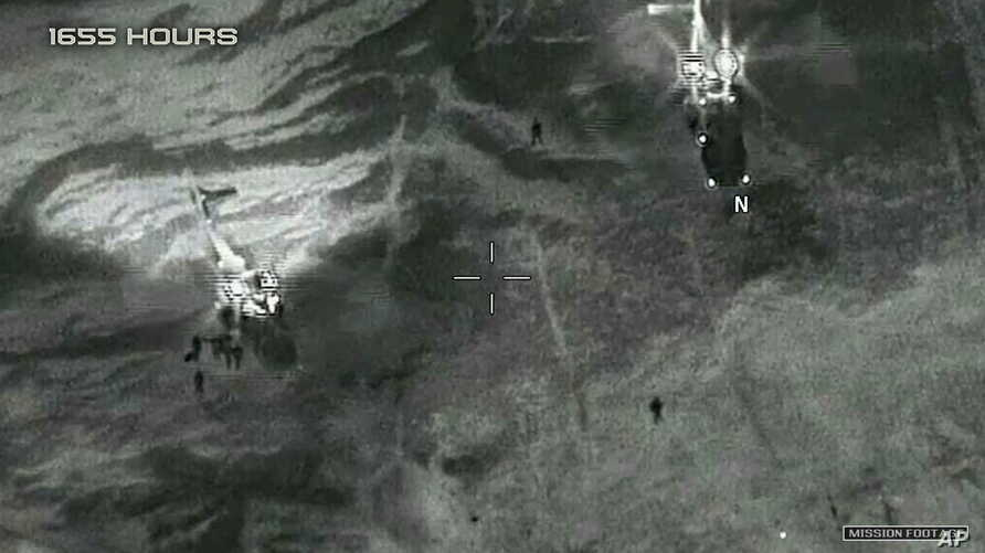 This image from video released by the Department of Defense, shows two French helicopters evacuating the U.S. service members in Niger in October 2017, after a ambush by Islamic State-linked militants.