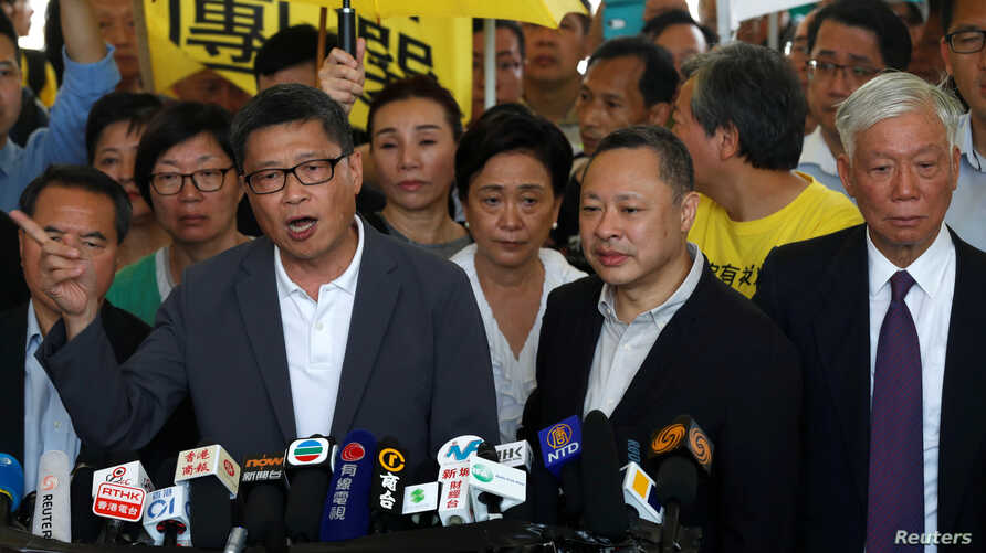 """Occupy Central pro-democracy movement founders Chan Kin-man, Benny Tai and Chu Yiu-ming arrive at the court for sentencing on their involvement in the Occupy Central, also known as """"Umbrella Movement,"""" in Hong Kong, China, April 24, 2019."""