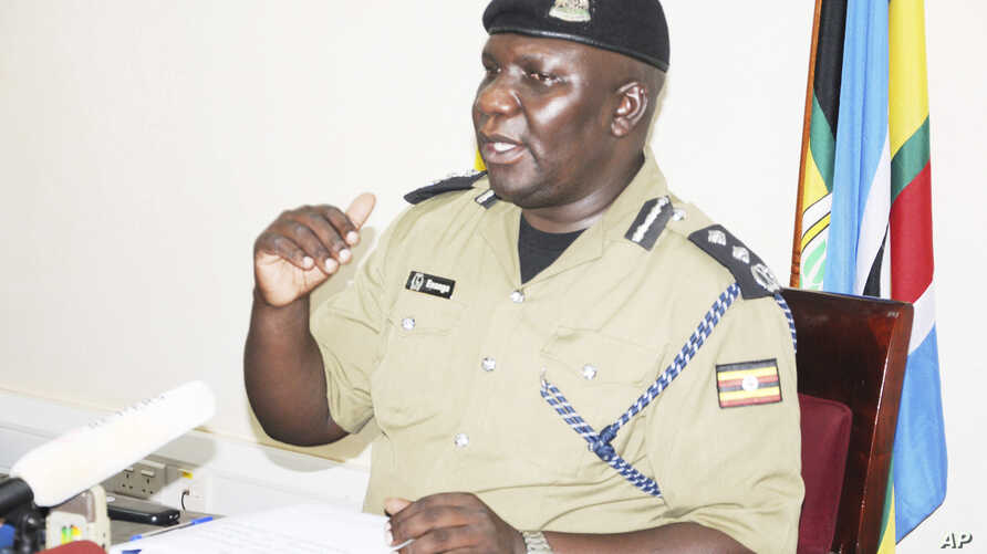 Ugandan police spokesman Fred Enanga addresses a news conference at Police headquarters in Kampala, April 8, 2019.