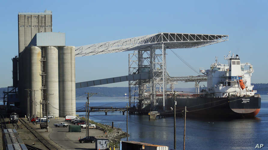A bulk carrier ship is loaded, May 10, 2019, at the Temco grain terminal at the Port of Tacoma in Tacoma, Wash. U.S. and Chinese negotiators resumed trade talks Friday under increasing pressure after President Donald Trump raised tariffs on $200 bill...