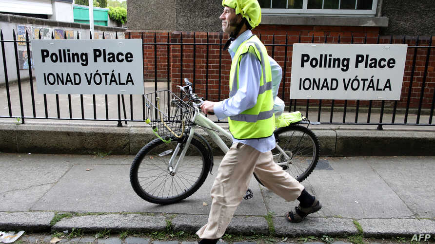 FILE - A voter leaves after casting his ballot in the European Elections, and in Ireland's Local Elections and the Divorce Referendum, being held concurrently, at a polling station at Drumcondra National school, in Dublin, May 24, 2019.
