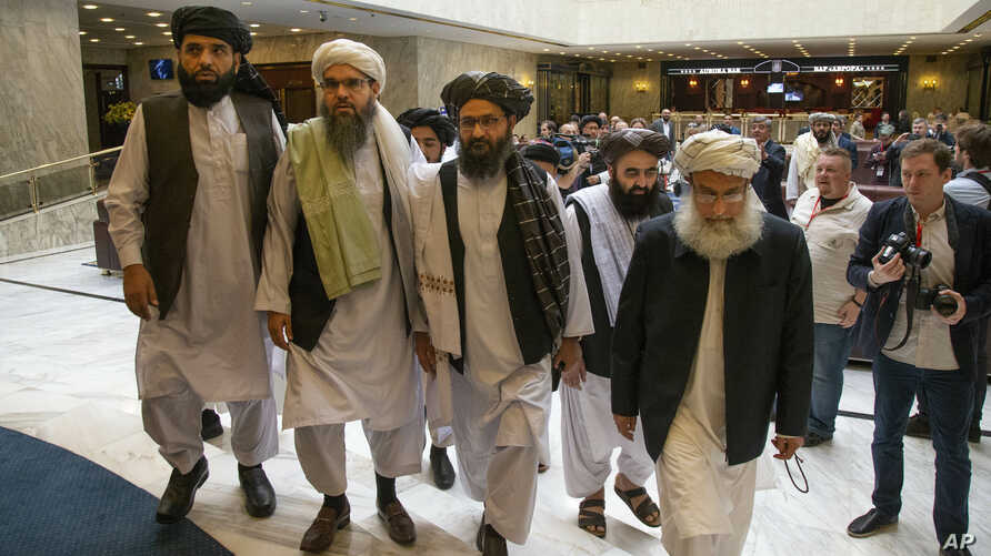 Mullah Abdul Ghani Baradar, the Taliban group's top political leader, third from left, arrives with other members of the Taliban delegation for talks in Moscow, Russia, May 28, 2019.