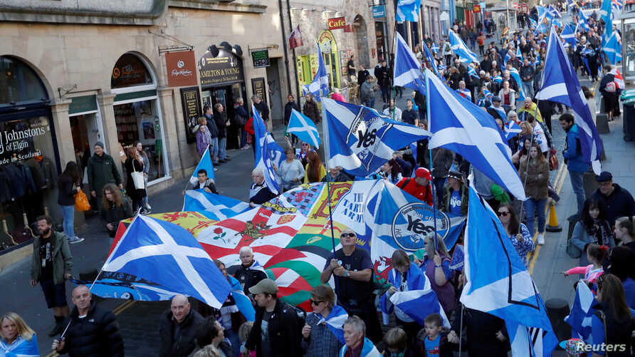 "FILE - ""All Under One Banner"" pro-independence protesters take part in a march and rally in Edinburgh, Scotland, Oct. 6, 2018."