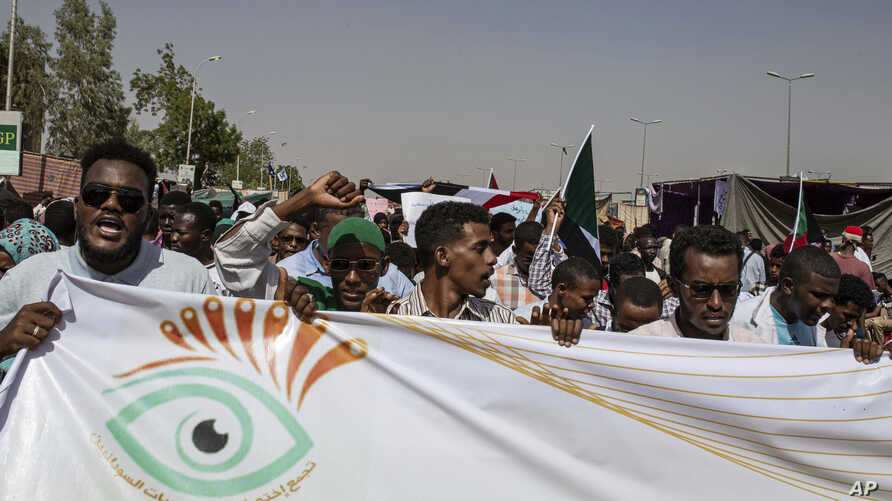 FILE - Protesters chant against military rule and demand the prosecution of former officials, at the Armed Forces Square, in Khartoum, Sudan, April 28, 2019.